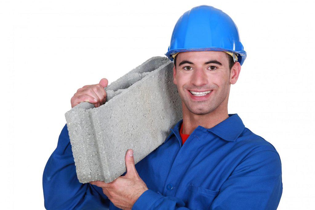 masonry worker holding a brick